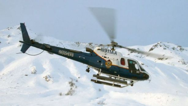 Associated Press/Alaska State Troopers - This 2008 image provided by the Alaska State Troopers shows their helicopter which crashed Saturday night March 30, 2013 while attempting to rescue a snowmobiler near Larson Lake 7 miles east of Talkeetna, Alaska. All three aboard are feared dead. (AP Photo/Alaska State Troopers)